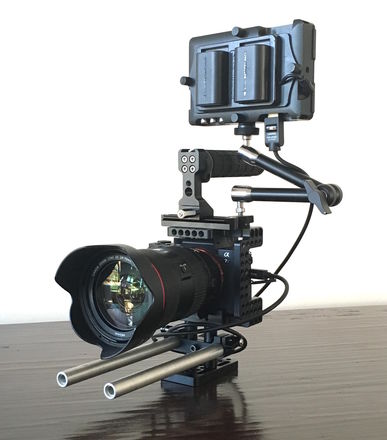 Sony A7sII with Cage, Canon lenses, Monitor, and Tripod